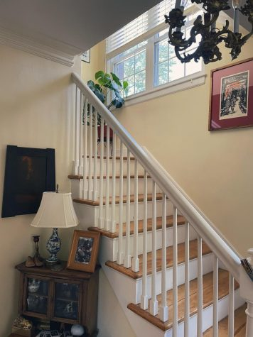 The stairway at my dads house cloaked in mid-day sunshine.