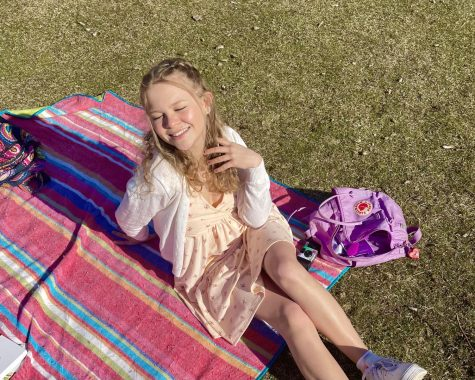 Savannah soaking up the sunshine at an outdoor picnic with friends.