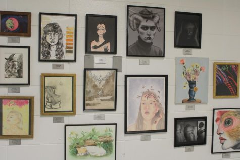 The collection of projects that greets students and staff as they enter the Art Department.