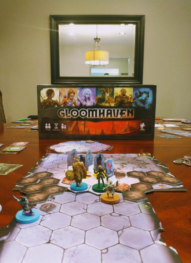 My friends and I fighting in a mid-scenario battle against Gloomhavens Spitting Drake, Cultist, and Living Bones.