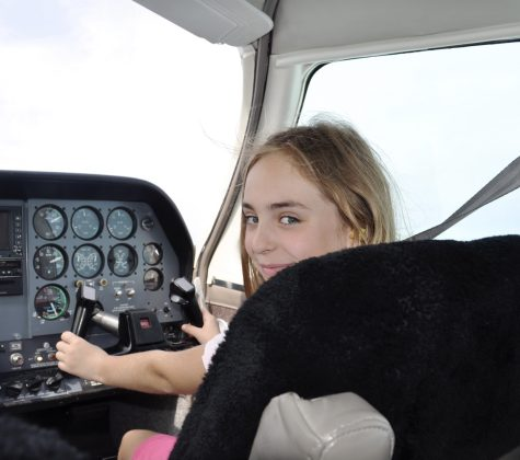 Lauren Speicher flying a plane as a student pilot in the cockpit
